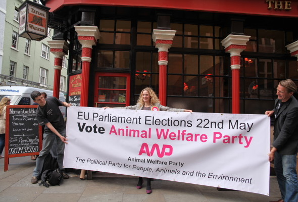 Soho pub, The Coach and Horses lends its support to the Animal Welfare Party's EU election bid with a statement banner and staff decked out in AWP t-shirts